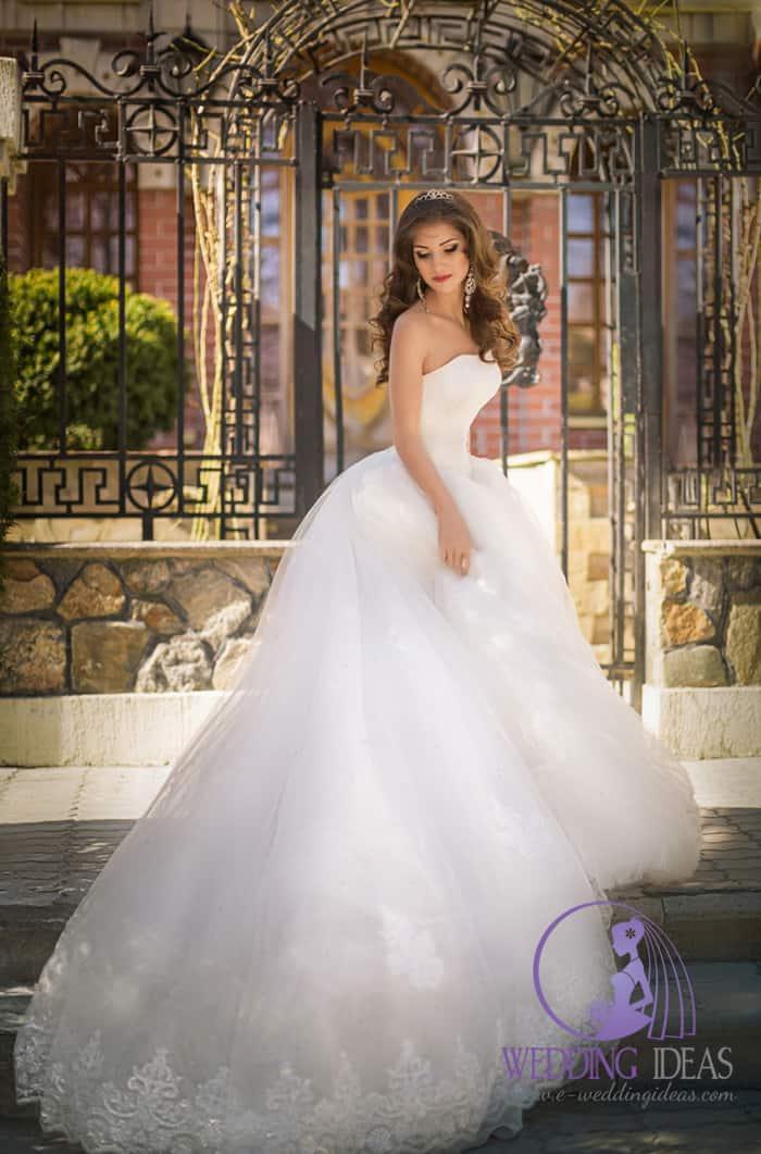 Strapless ball wedding dress with a straight neckline.