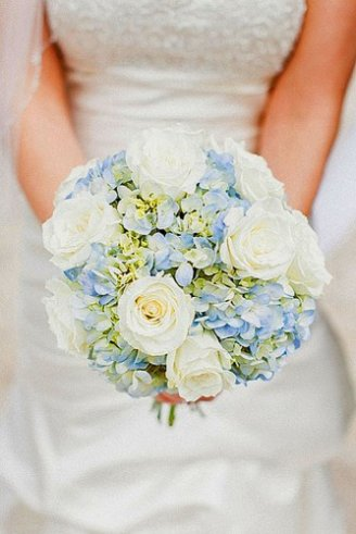 bouquet with white roses and light blue flowers