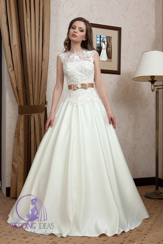 A white bridal dress with a cowl bust.