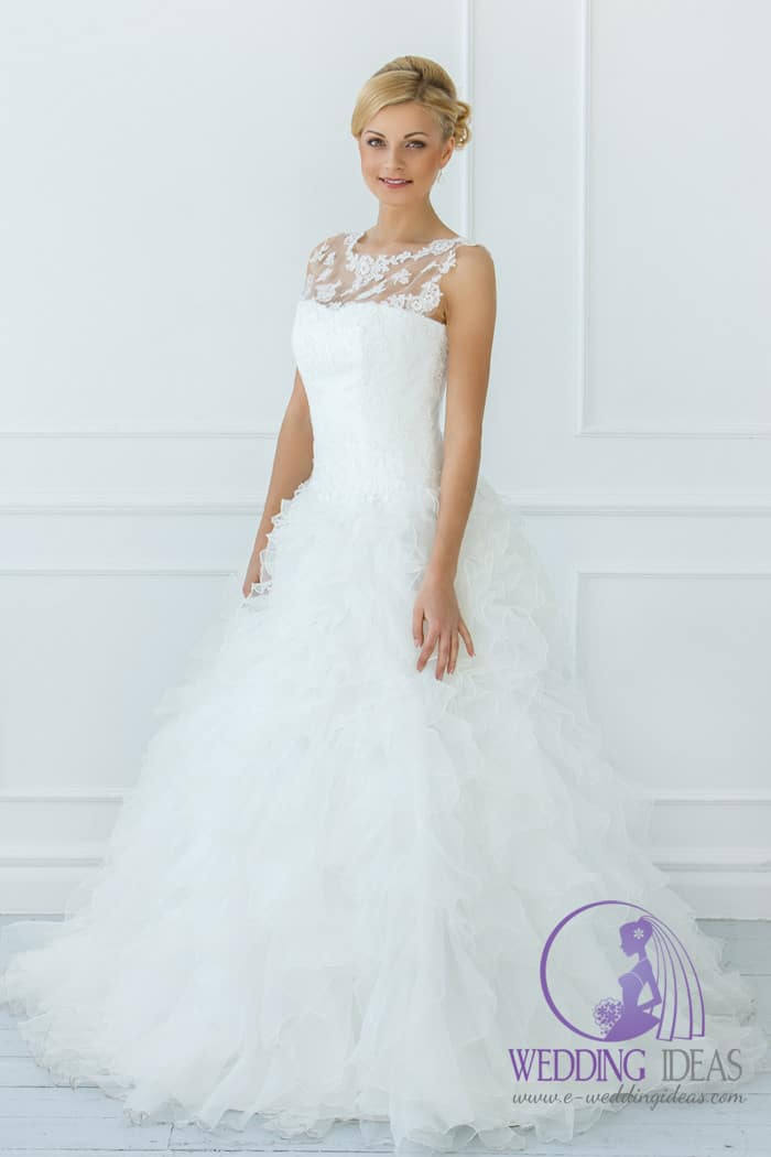 Illusion necklace with lace on the top and tulle skirt.