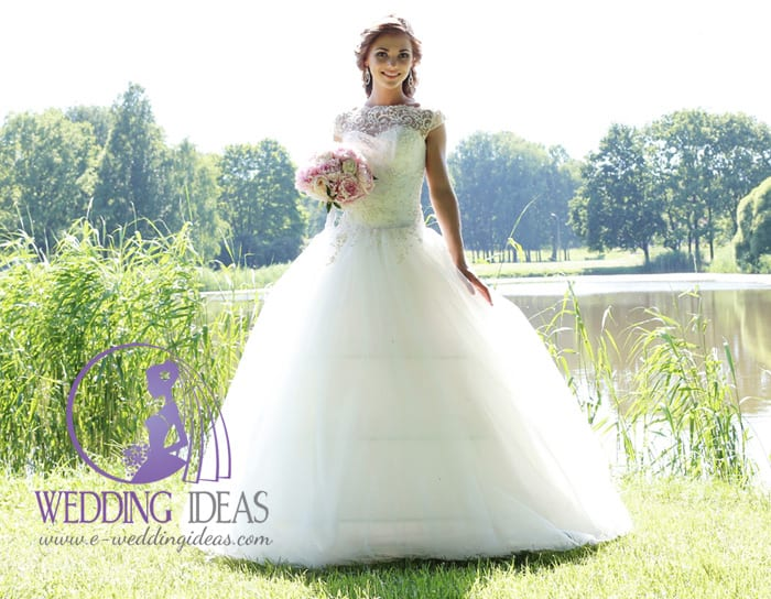7. Princess tulle wedding dress with an illusion neckline and crystal bodice.