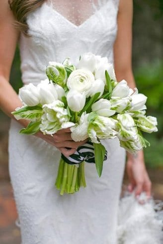 Tulips - white, closed flowers; Parrot Tulip - white-green torn flowers at the bottom of the bouquet; White Ranunculus - white flower in the center of the bouquet