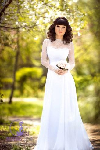 A white, long-sleeved wedding dress