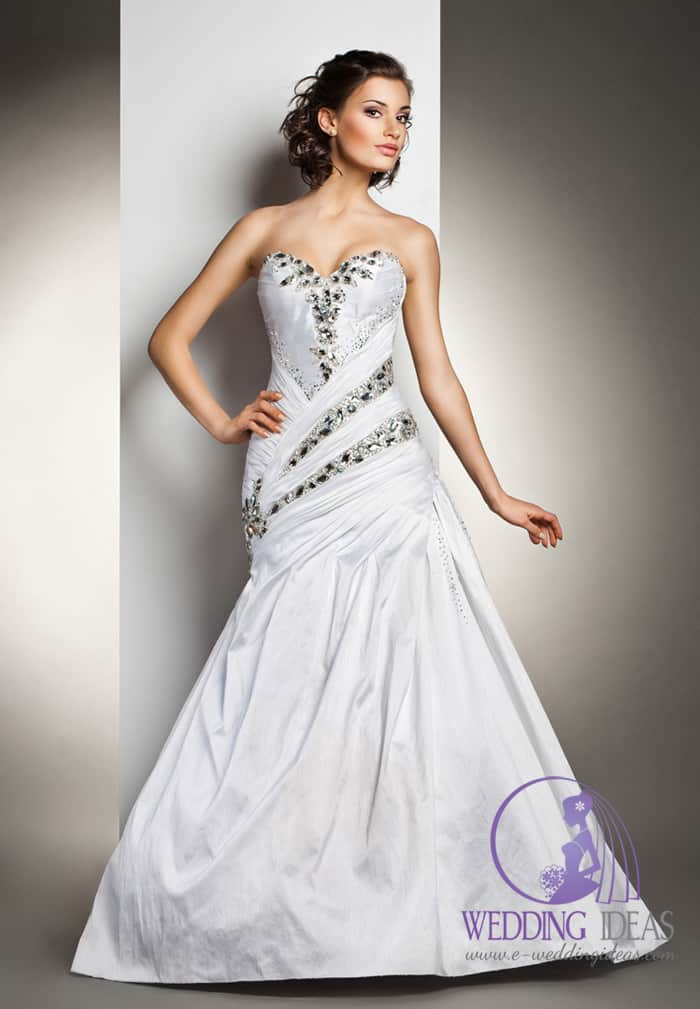 Mermaid gown with sweetheart necklace, and crystals on the bodice.