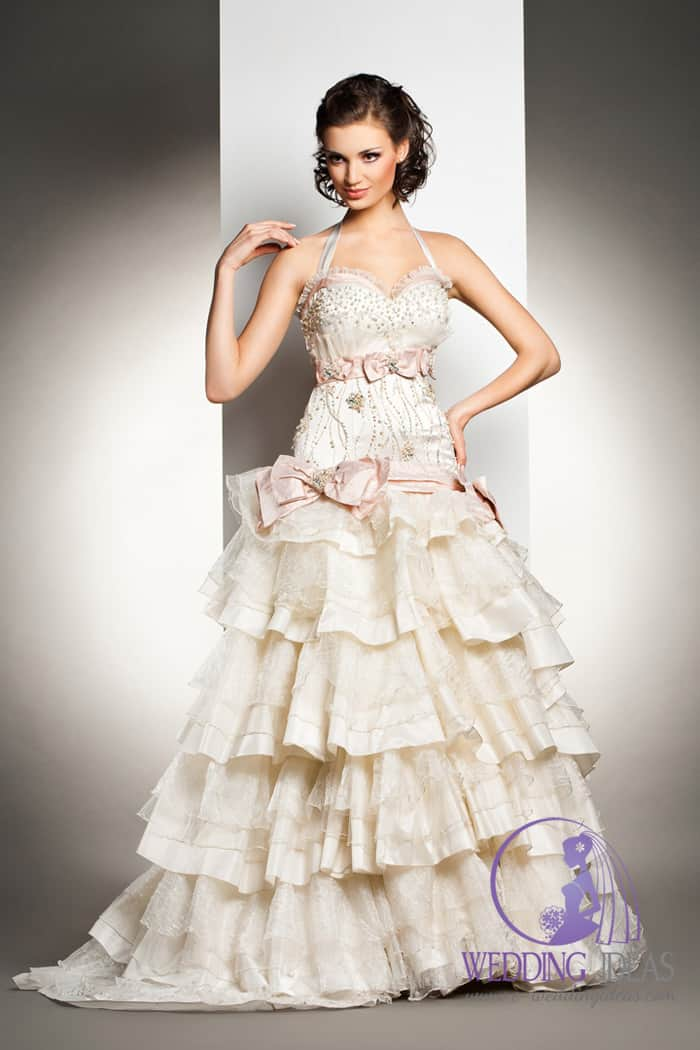 Halter strap with crystal on the bodice, and pink belt with tulle and bow.