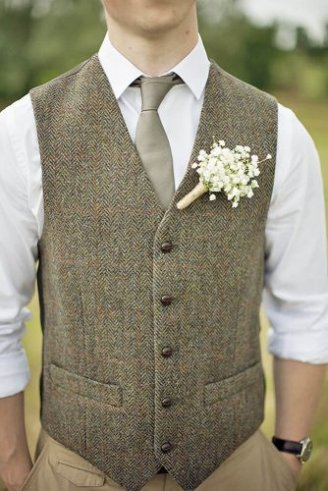 groom in a brown checked sleeveless blazer, white shirt, grey tie and a white and green boutonniere