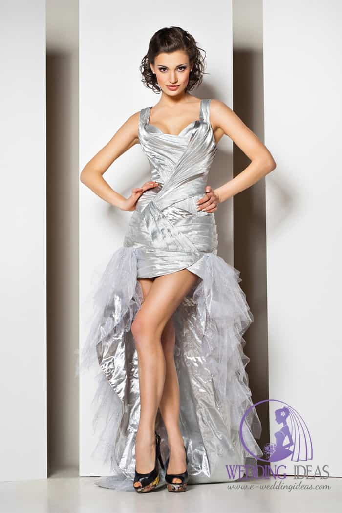 Silver hi-low dress with tulle on the skirt. Black high heels with colorful wood on the bottom.