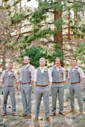 Groomsmen in grey sleeveless suits, dark brown shoes, pink shirt and pink boutonnieres