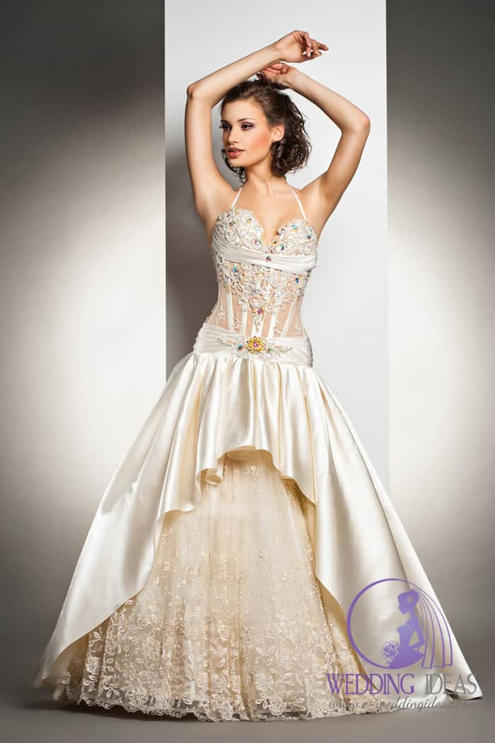 Halter strap with see trough bodice, and colorful crystals on the bodice.