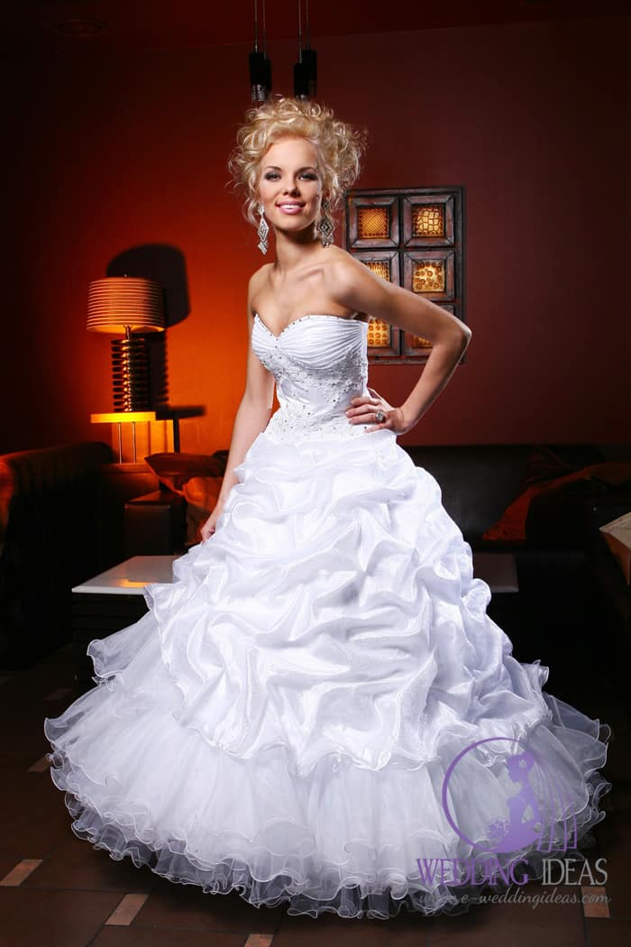 Sweetheart satin and lace neckline with crystals and satin and tulle skirt.