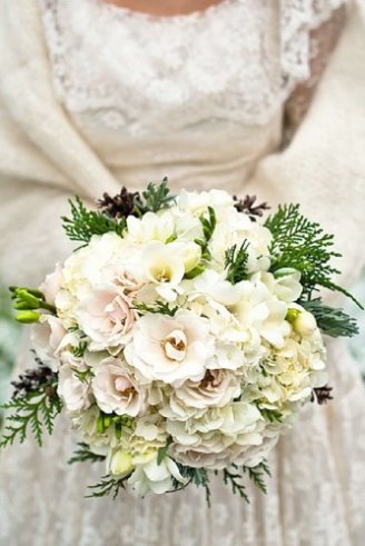 A lovely wedding bouquet consisting of thin green leaves and white flowers