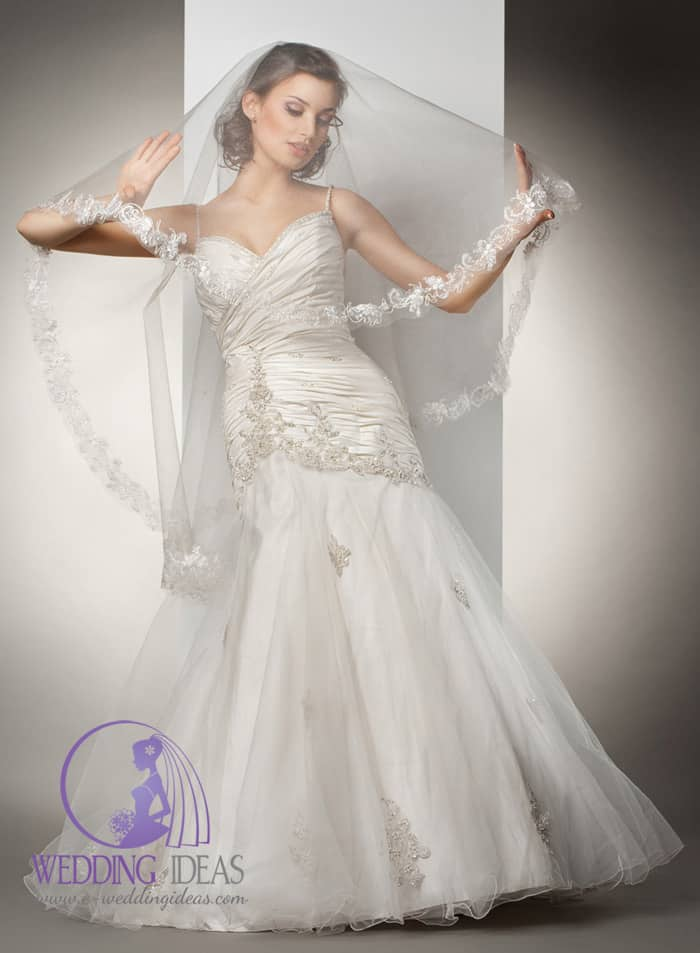91. Layered satin bodice with spaghetti strap. Tulle skirt, crystal flowers elements on the bodice and skirt. Long veil where bride hide her face with lace on the end.