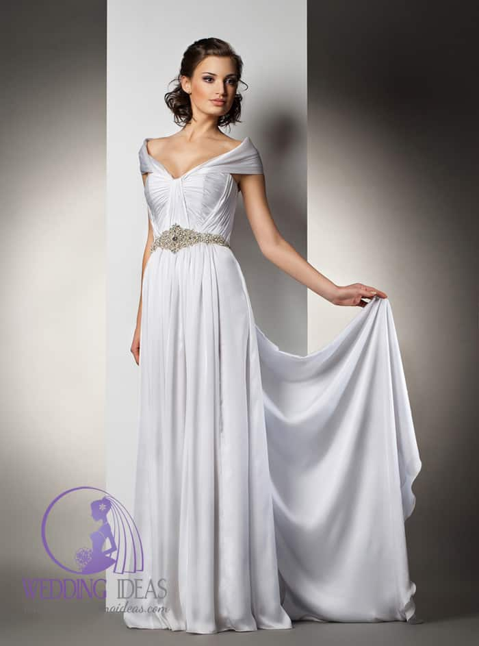 93. Off-shoulder light silver dress with crystal belt in the waist. Bride hold train in the left hand. Brown pinned up hair with natural make up.