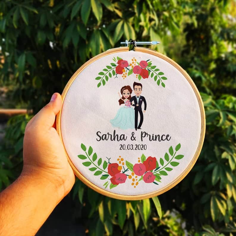 Custom hoop art with an anime photo of bride and groom
