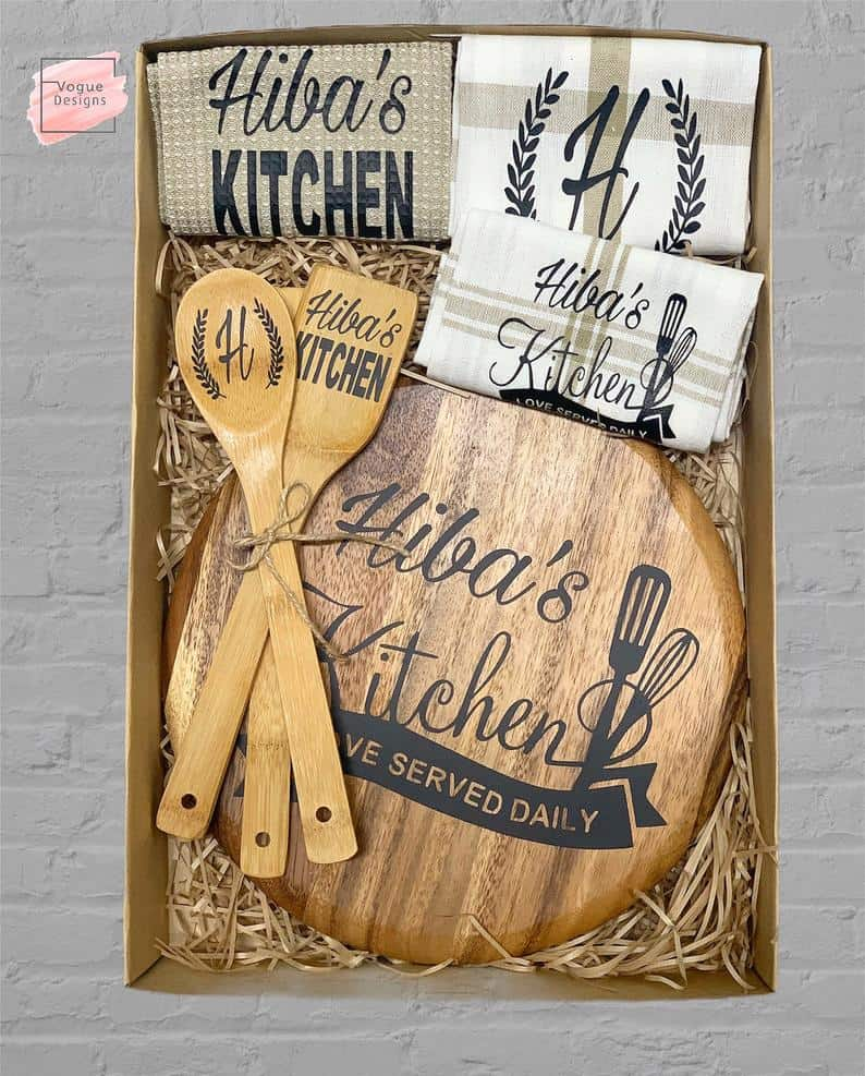 personalized chopping board with wooden spoon and fork perfect as a housewarming gift