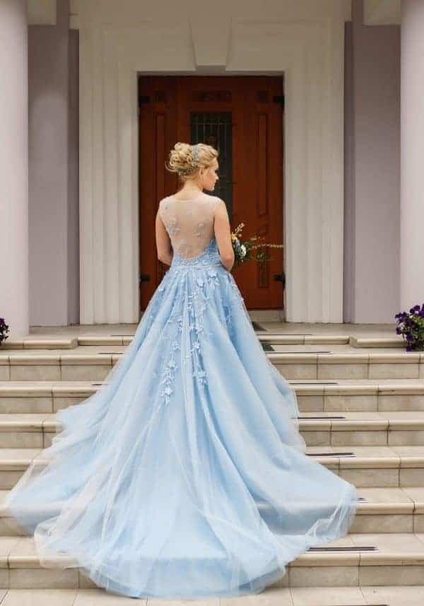 A super long blue wedding dress with a sweetheart-shaped bust
