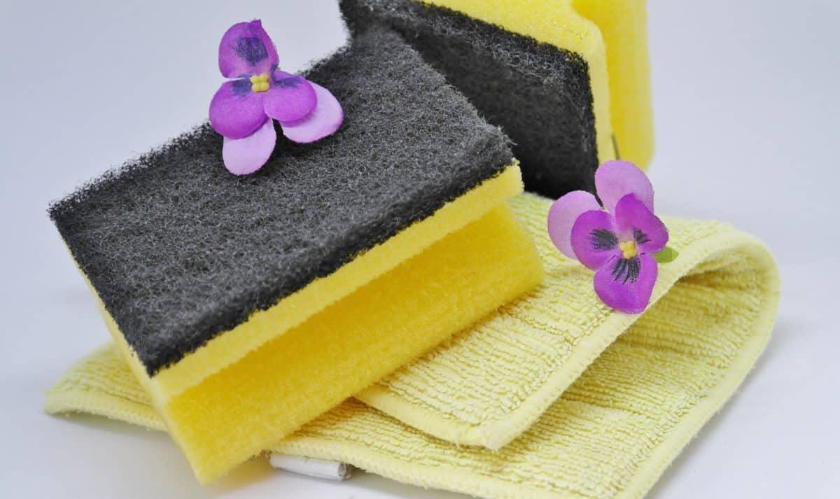 yellow dishtowel under sponges
