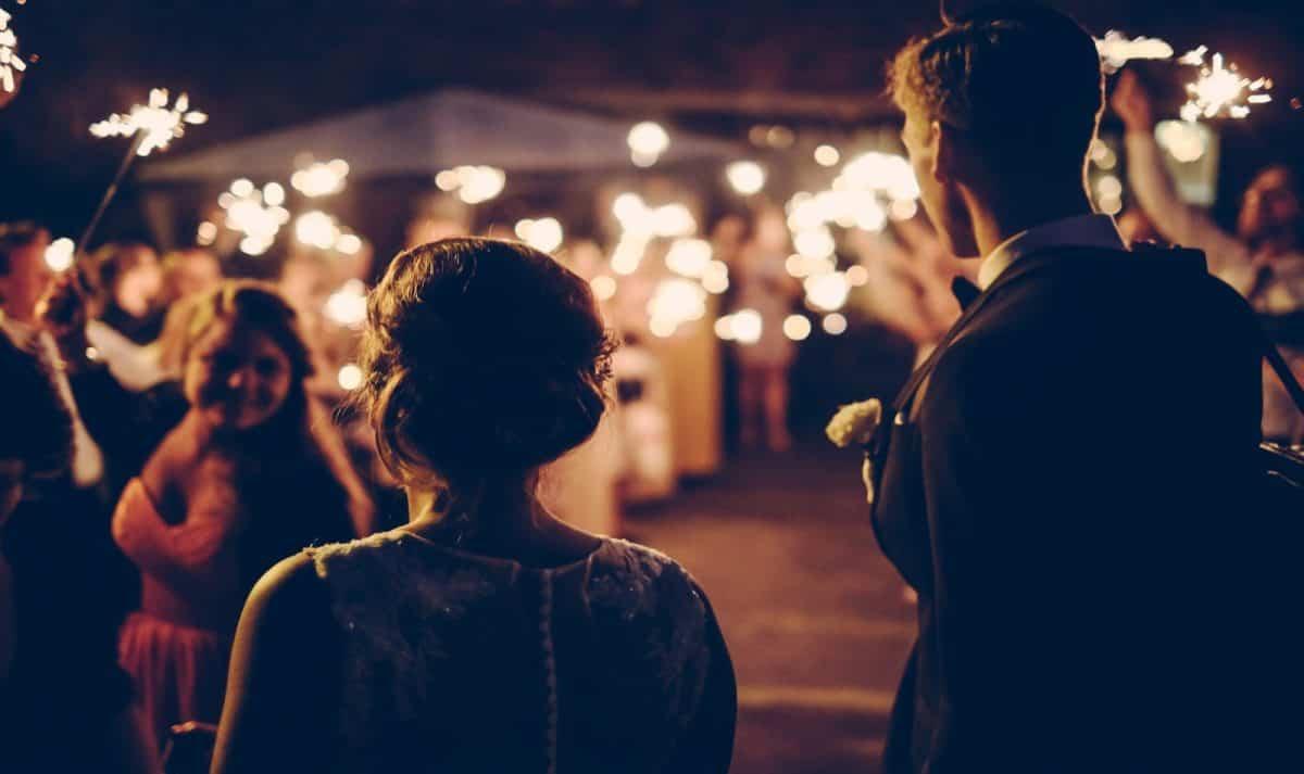 bride and groom celebrating after a surprise wedding