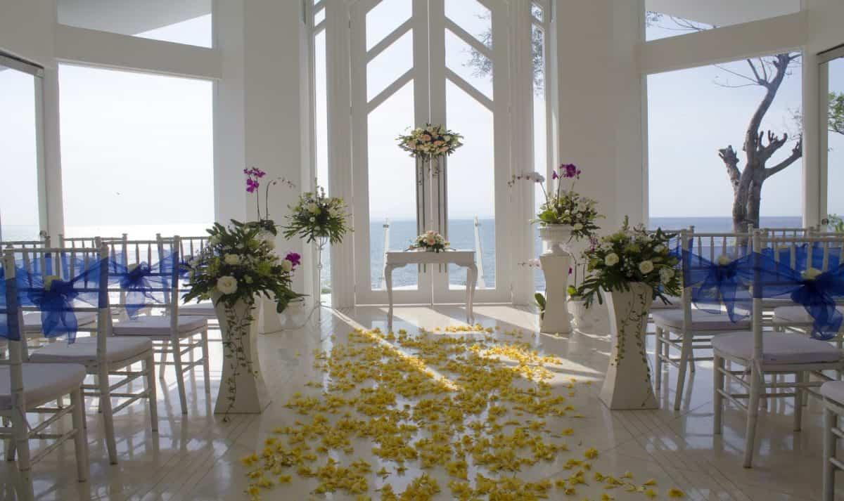 wedding aisle full of yellow flowers