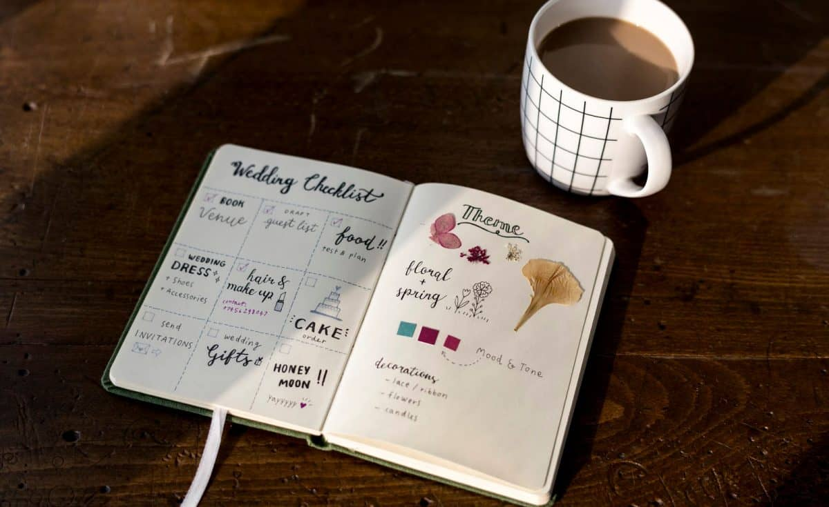Closeup of wedding checklist notebook on wooden table