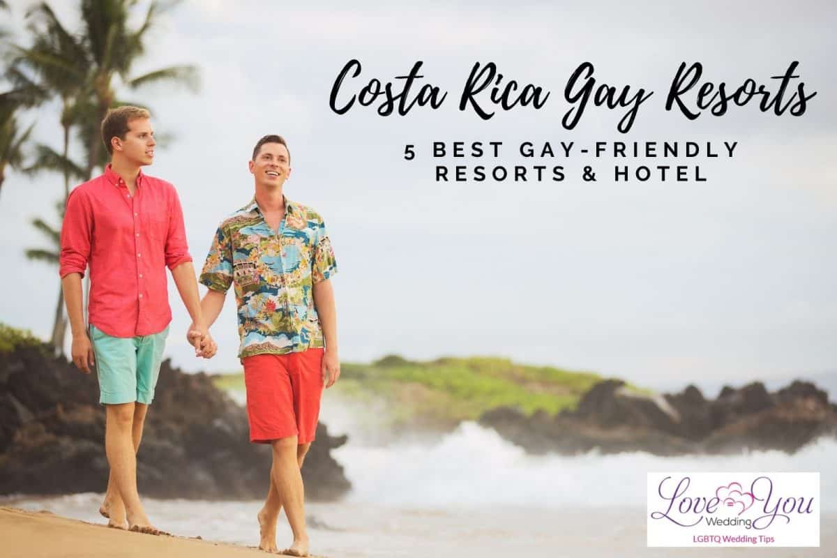 a lovely gay couple walking at the beach in a costa rica gay resort