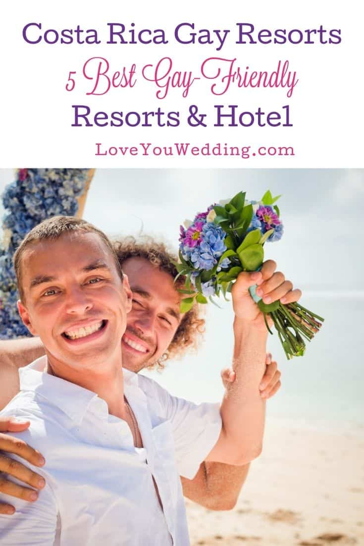 gay couple with one holding a bouquet in a costa rica gay resort