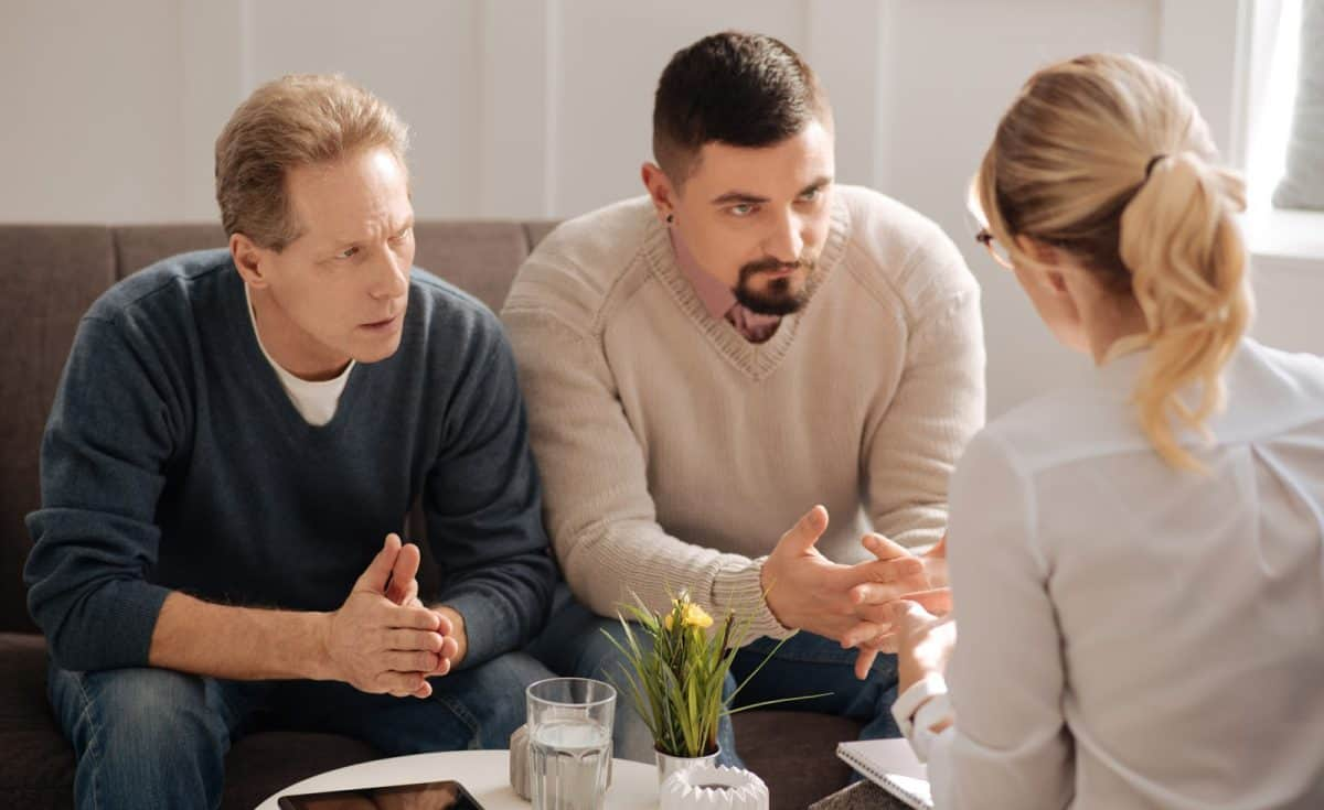 gay couple talking to a therapist
