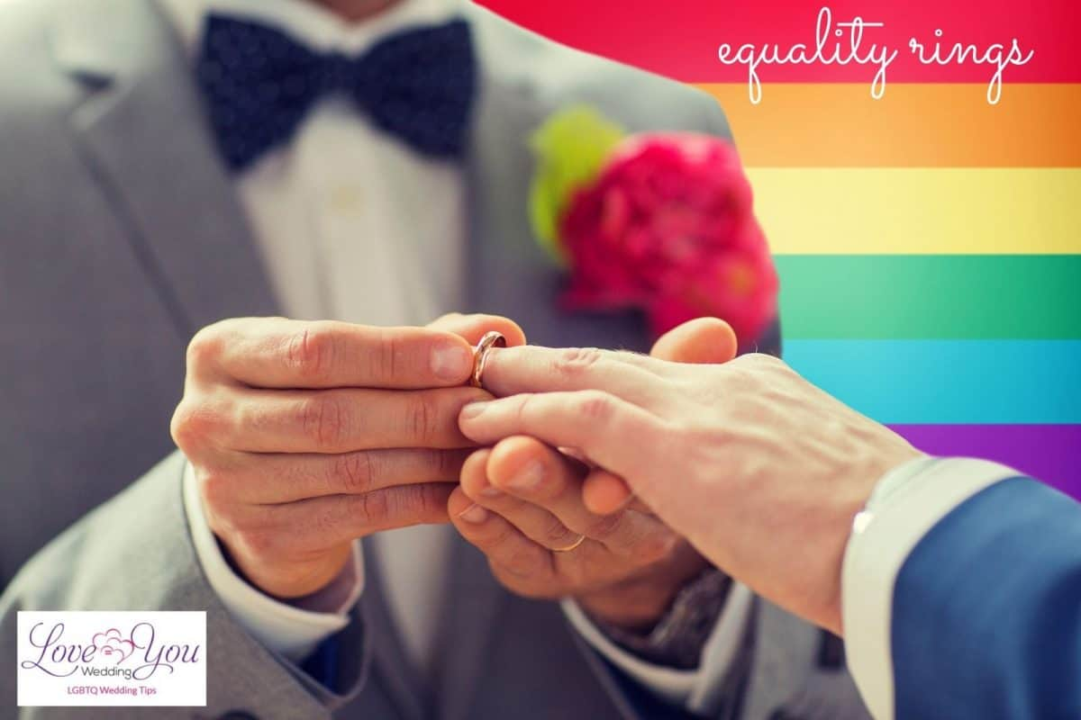 a man putting equality rings to his husband
