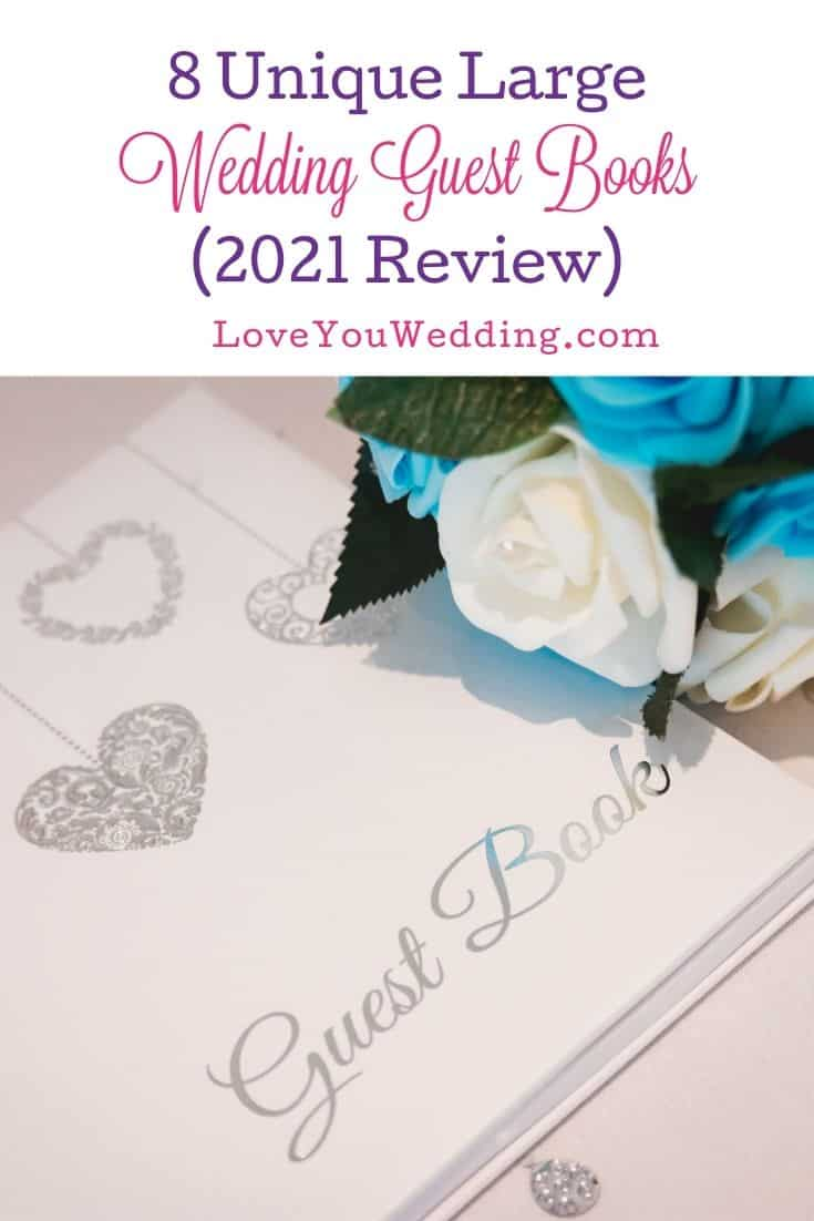 large wedding guest book beside flowers