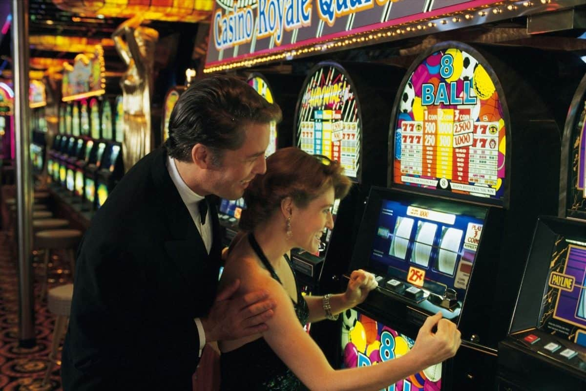 bride and groom playing in casino