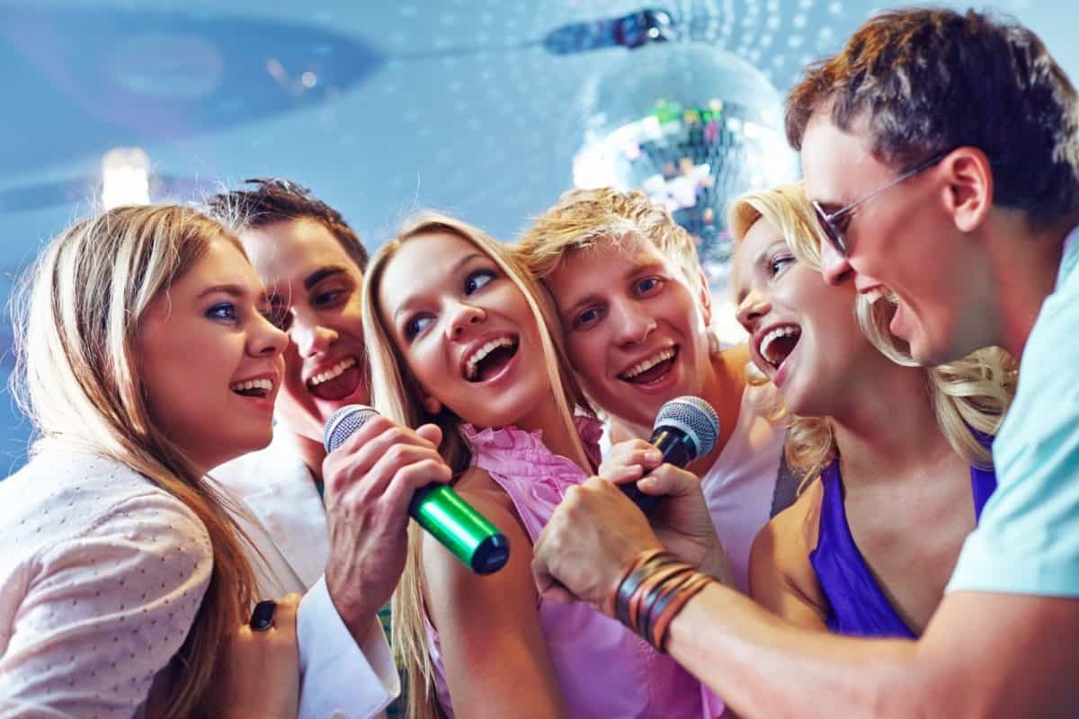 group of people having karaoke time