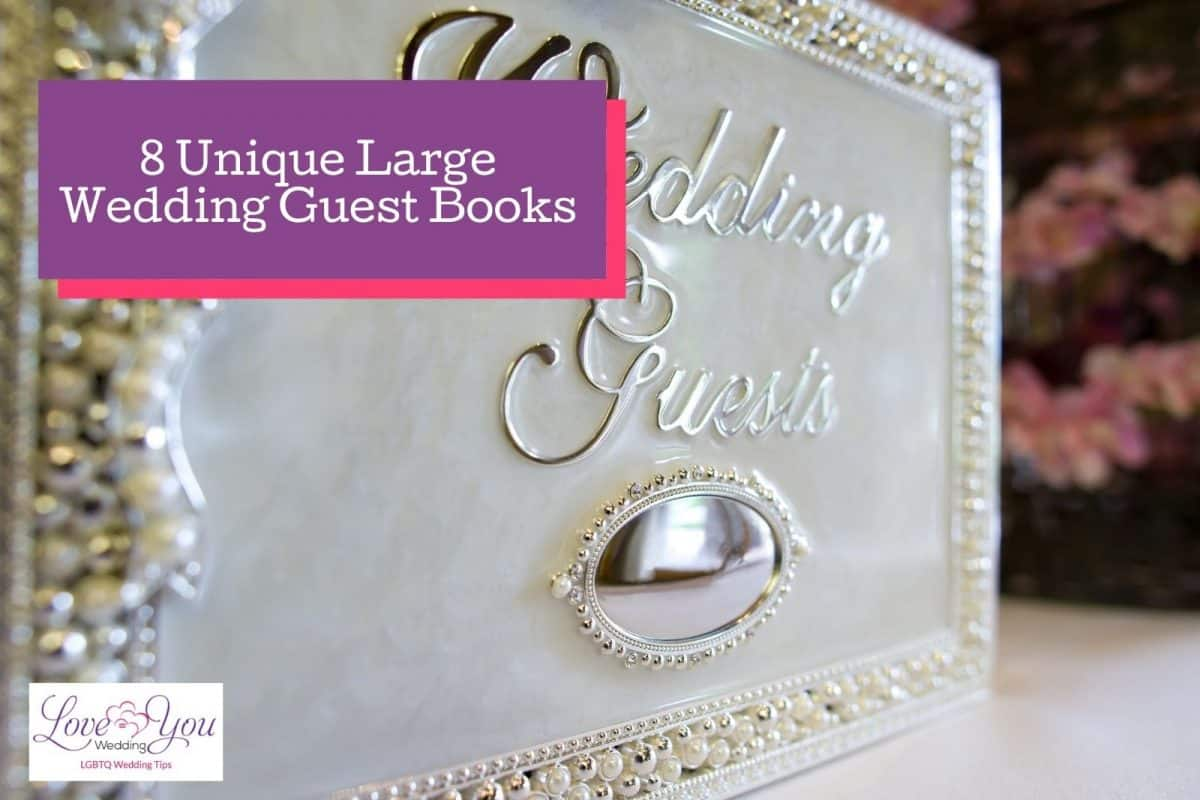 """a silver large wedding guest book with a cursive """"Wedding guests"""" lettering"""