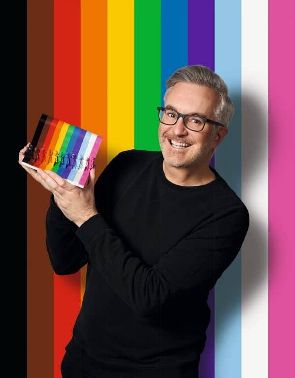 Matt Ashton modeling the new LEGO LGBTQ pride month playset