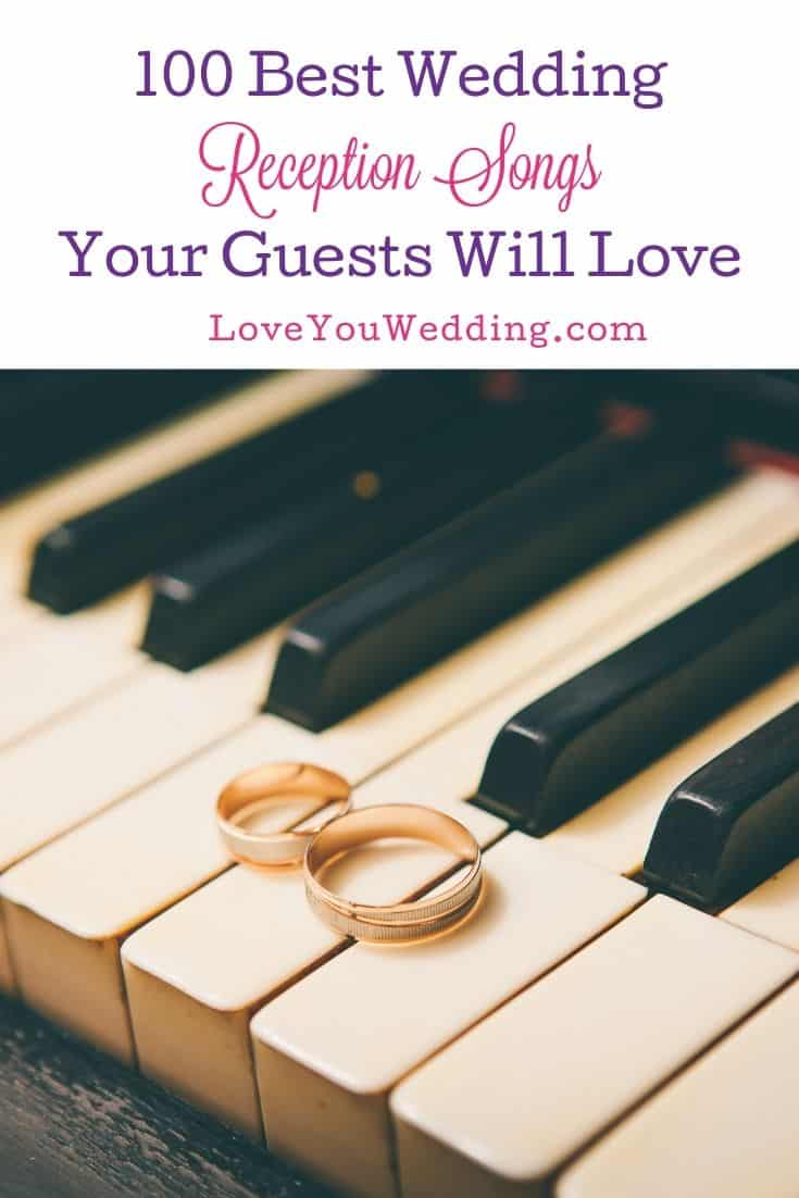 gold wedding rings on top of a piano