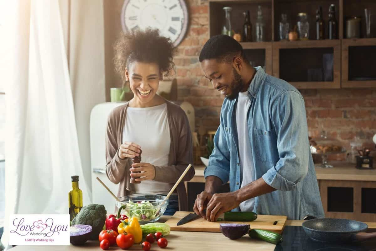 couple happily cooking together