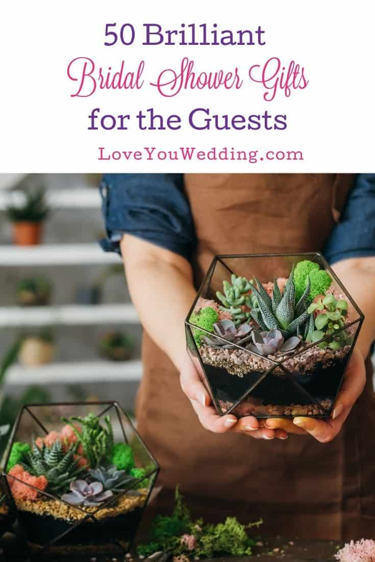 a woman holding personalized succulents as bridal shower gifts for guests