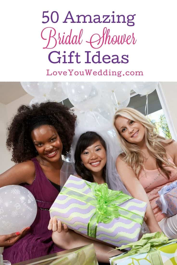 bride and friends holding different bridal shower gift ideas