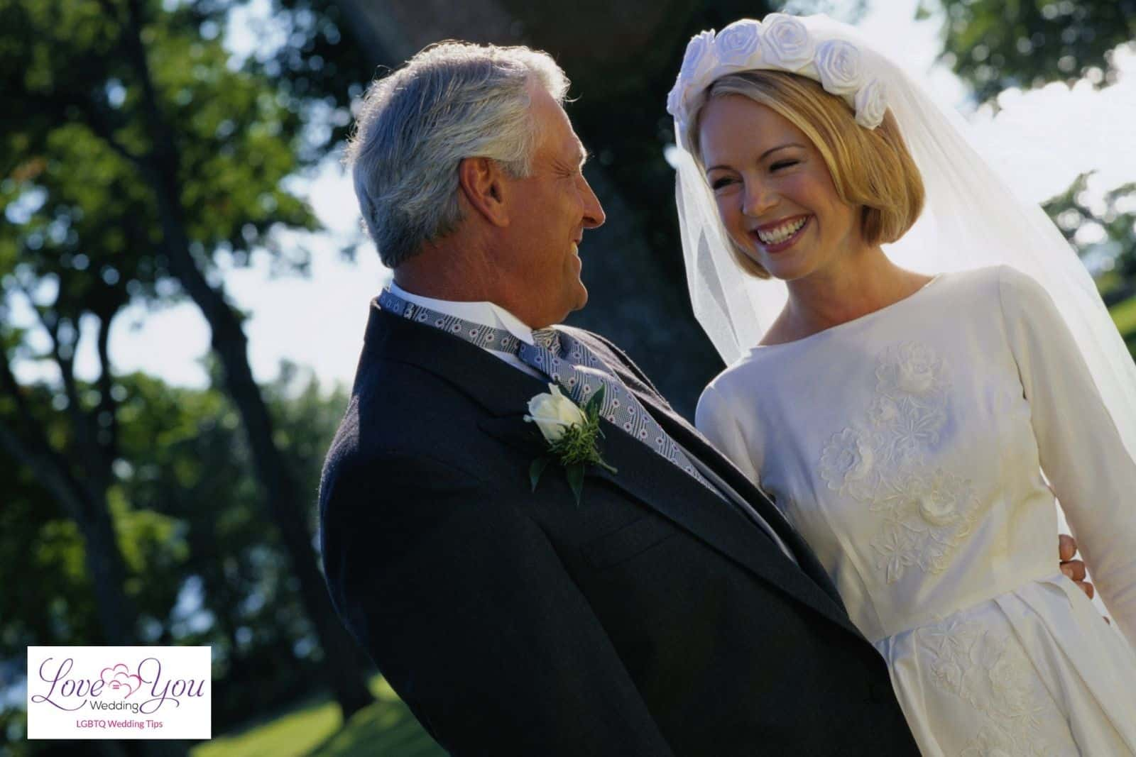 father and bride smiling at each other