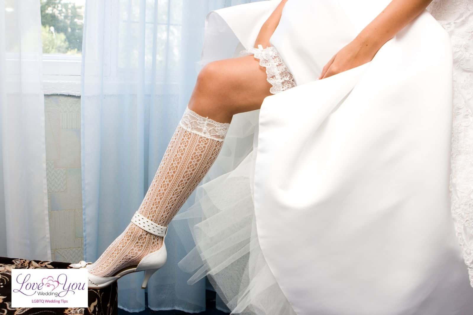 a bride wearing her bridal garter