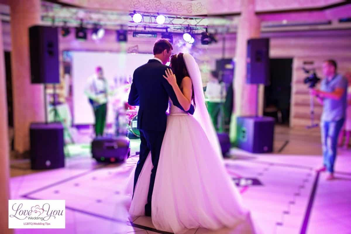 couple dancing while Michale Buble wedding songs are playing