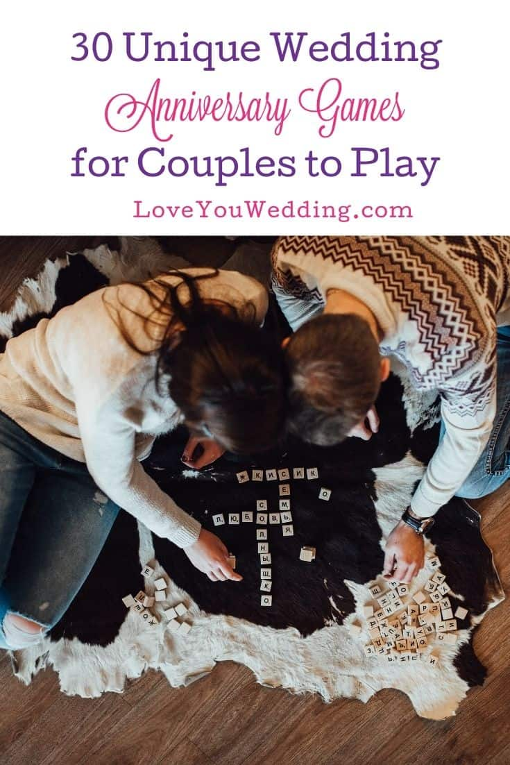 couple playing board game for their wedding anniversary