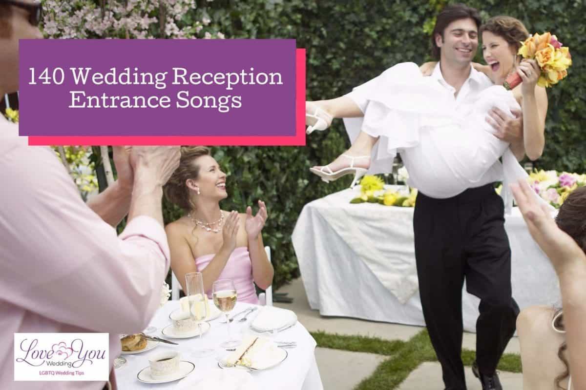 groom carrying the bride while wedding party reception entrance song is playing