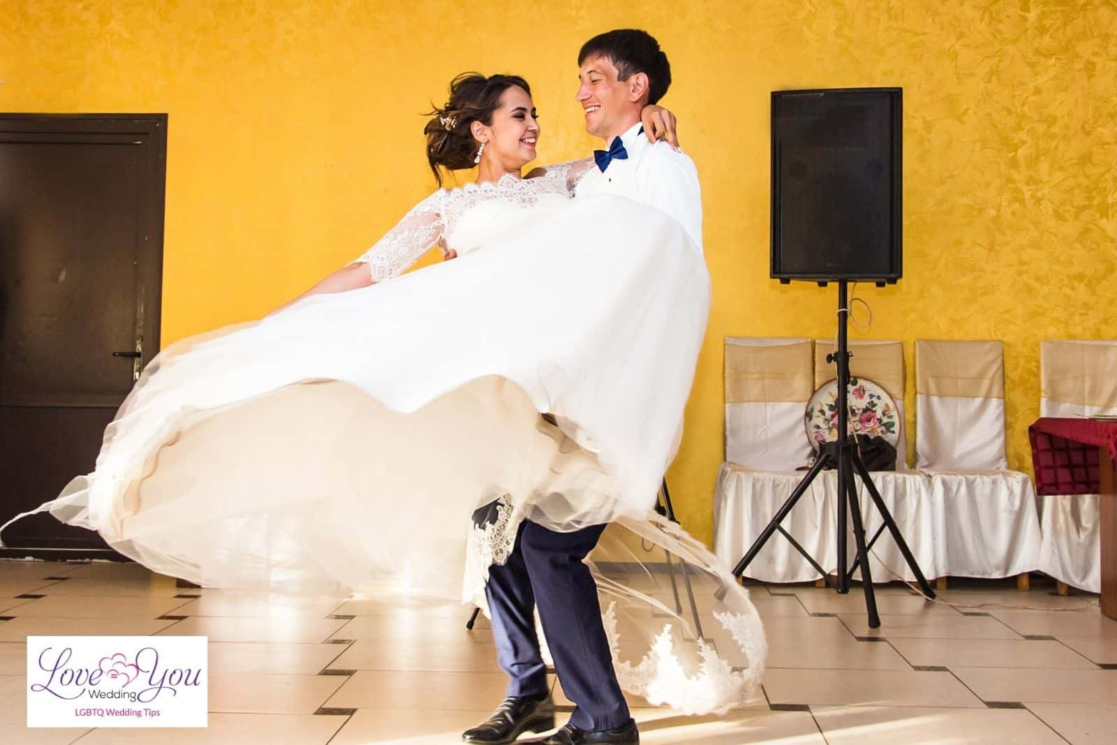 groom carrying the bride while dancing