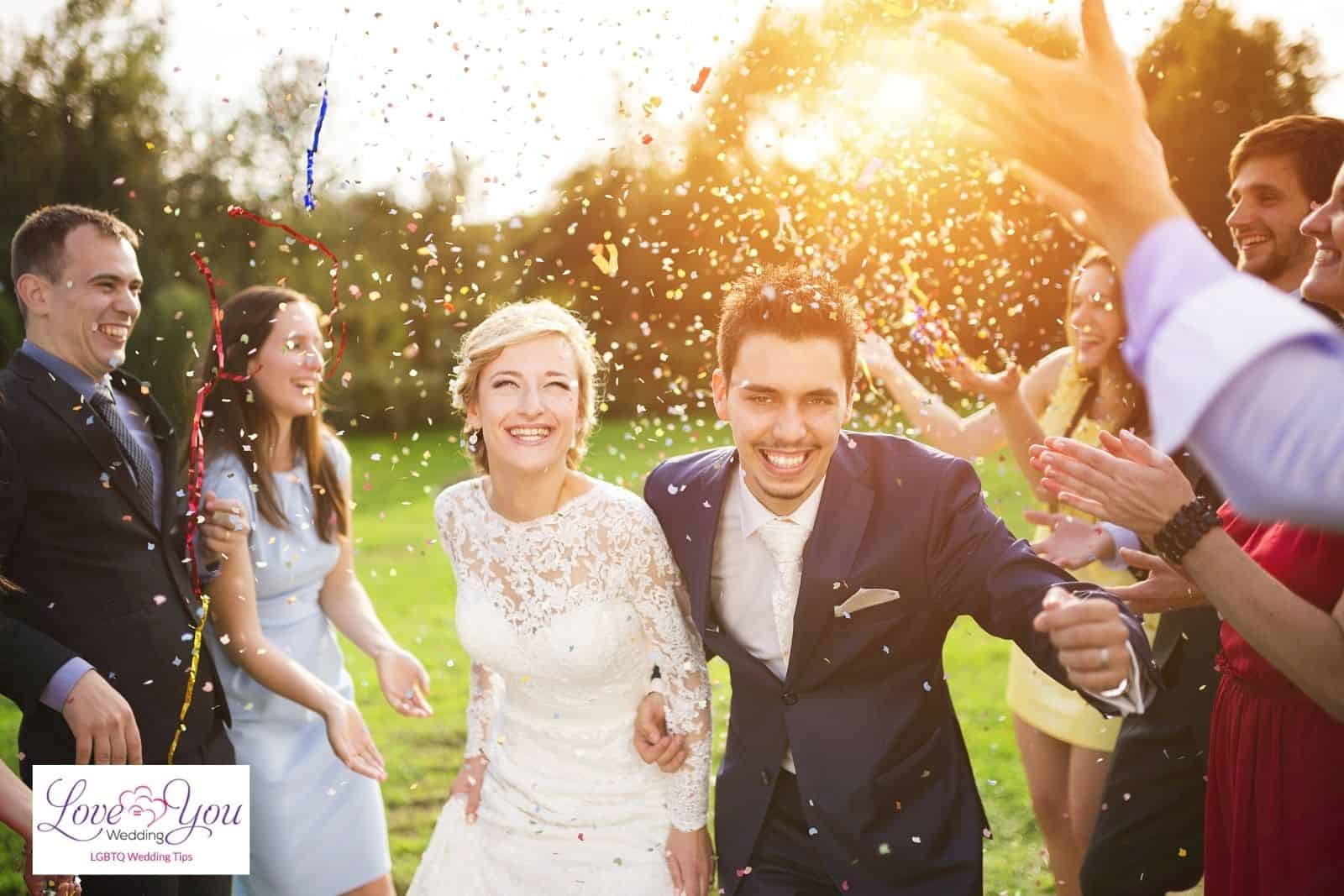 friends throwing confetti to the bride and groom