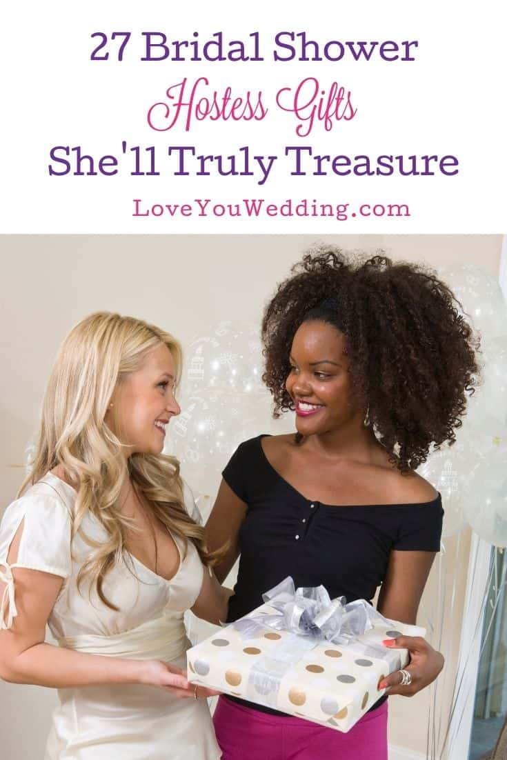 bride handing bridal shower hostess gifts to her maid of honor