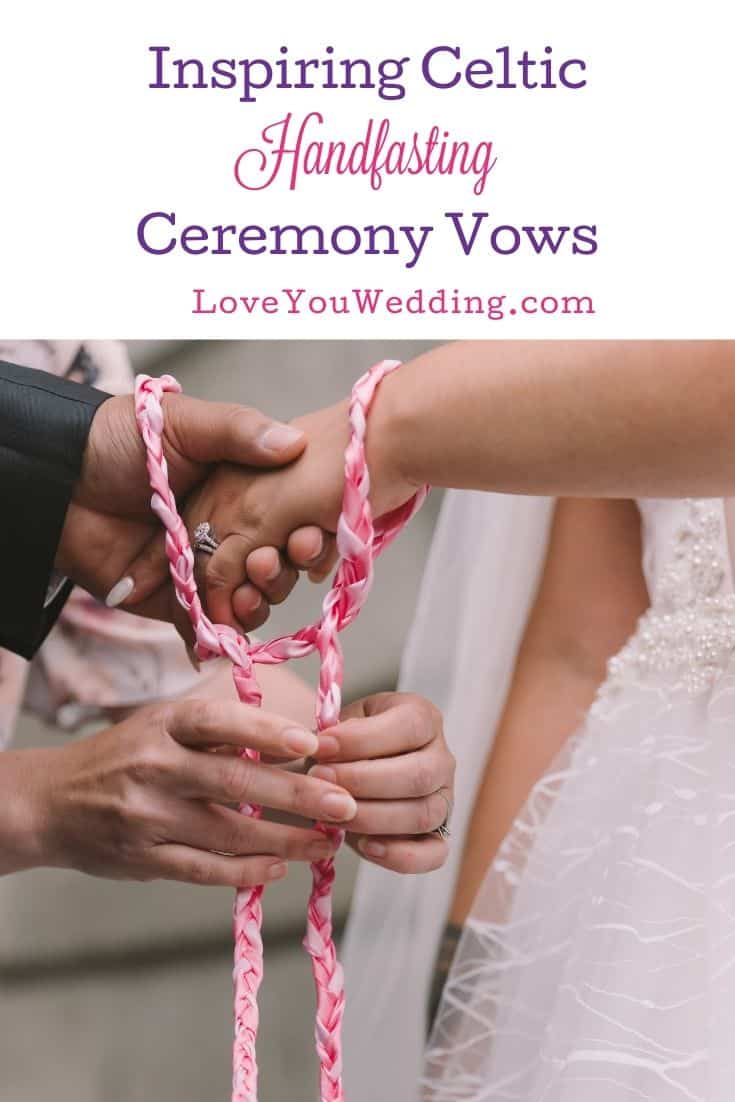 lady tying a ribbon to the bride's and groom's hands