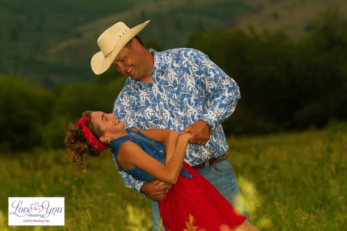 father and daughter wearing country outfit while dancing