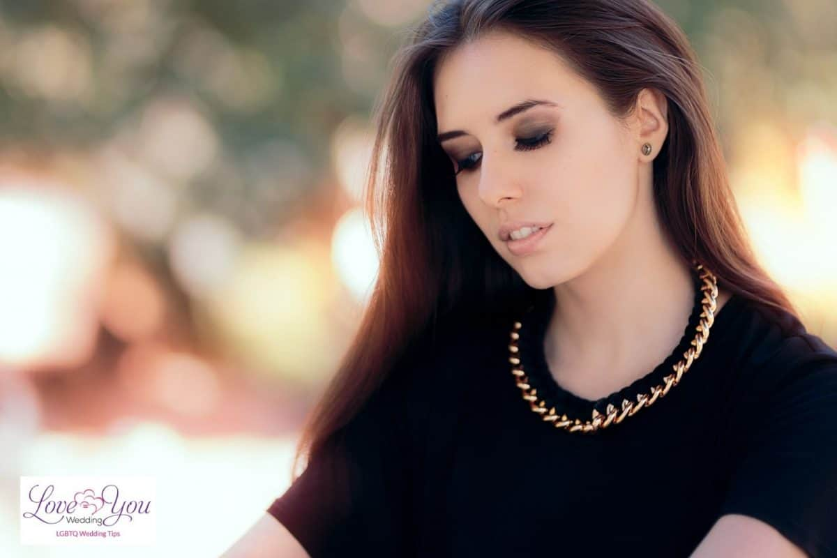 pretty girl wearing a large gold necklace