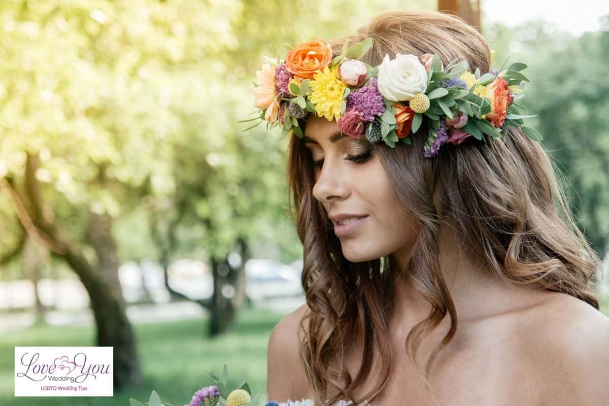 bride with curly hair with flowers on it