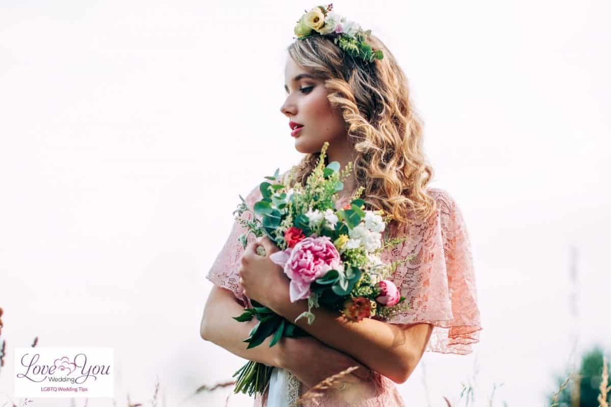bride with tight curls and flower crown